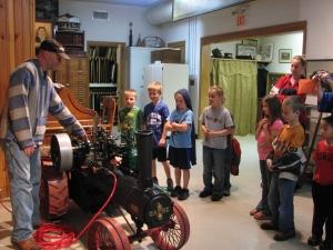 Students enjoying a steam engine demonstration.
