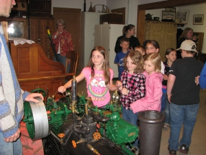 Students blowing the whistle on the steam engine.