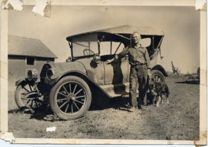 Ole N. Barsness with his 1914 Baby Grand.